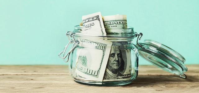 Dollar Bills in Glass Jar