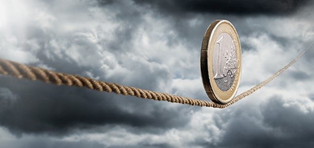 euro coin rolling unto a rope