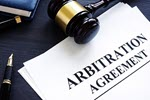 Securities Arbitration—Should You Hire an Attorney? ©iStockphoto.com/designer491