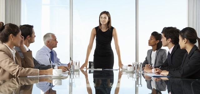 Group Of Business People Having Board Meeting
