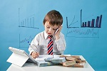 Young boy in tie with phone, notebook and money ©iStockphoto.com/tatyana_tomsickova