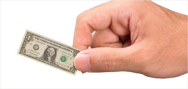 Hand holding miniature dollar