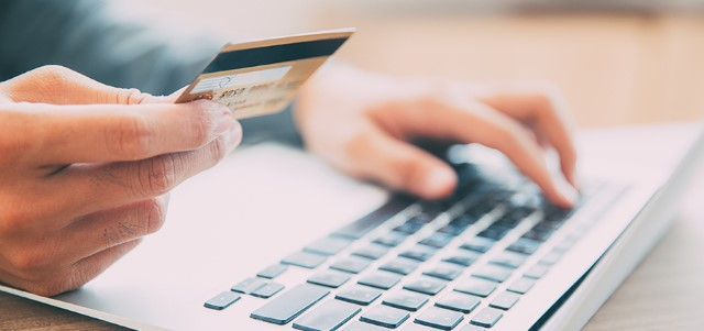 Man making online purchase with credit card ©iStockphoto.com/MangoStar_Studio