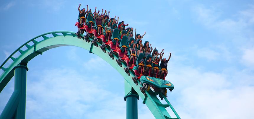 People riding a rollercoaster ©iStockPhoto/bukharova