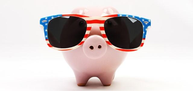 Piggy bank with retro sunglasses with USA flag