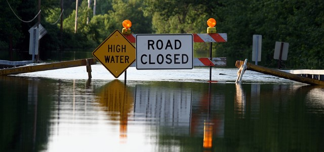 Road Closure Signage As Water Covers The Road
