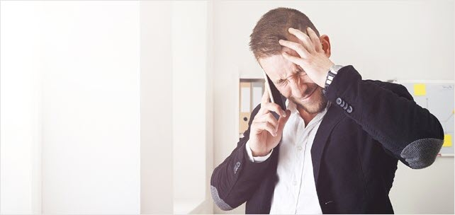 Young stressed businessman call mobile phone in modern office