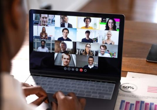Woman Meeting Virtually with Co-Workers
